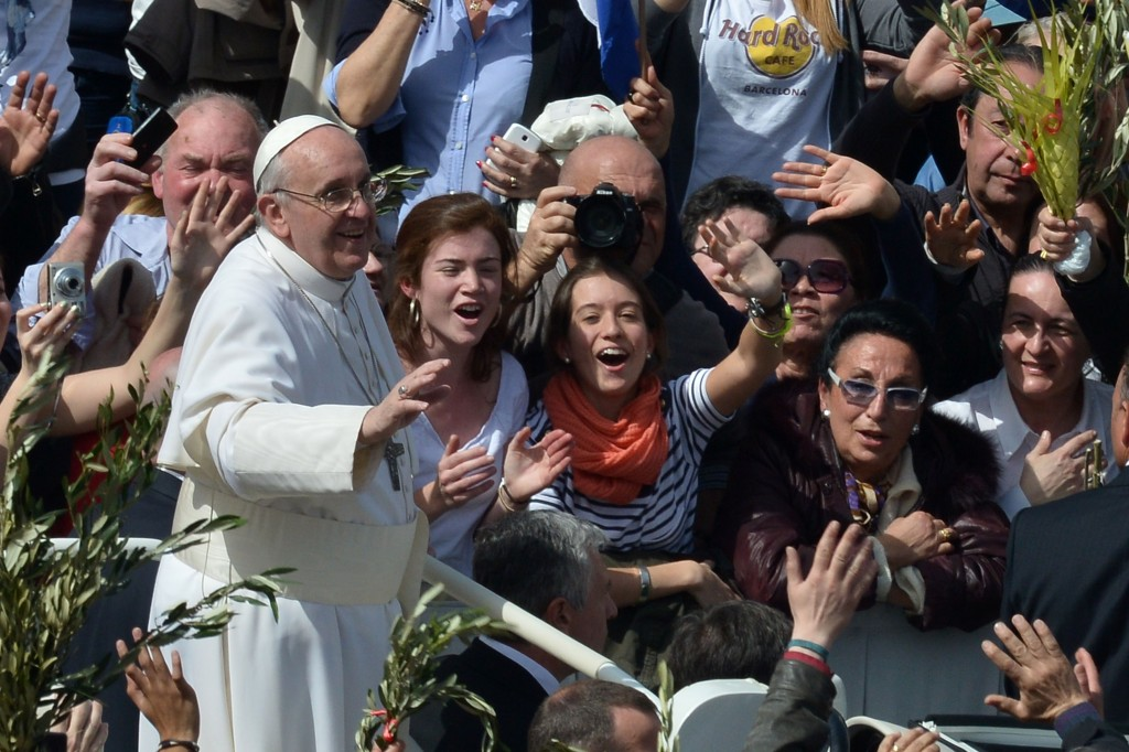 Pope Francis waves to the crowd after a mass on St Peter's squar