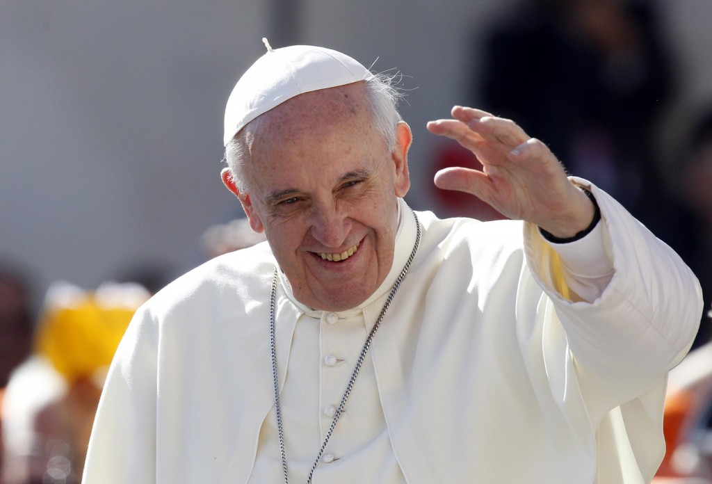 Pope Francis waves to faithful as he arrives for his weekly general audience in St. Peter's Square at the Vatican, Wednesday, Sept. 18, 2013. (AP Photo/Riccardo De Luca)