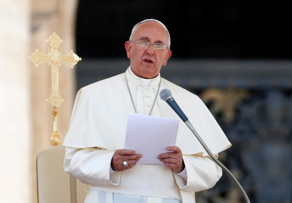 Pope Francis delivers his speech during an audience with Italian Carabinieri paramilitary police in St. Peter's Square at the Vatican, Friday, June 6, 2014.