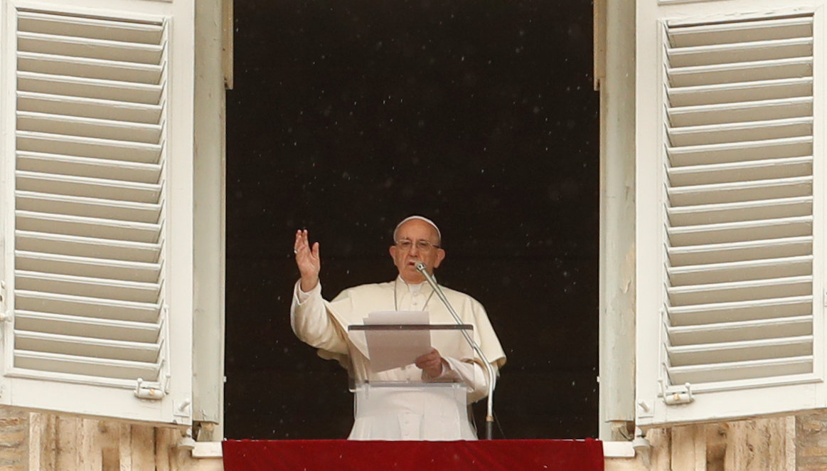 Pope Francis makes a blessing as he arrives for the Angelus prayer in Saint Peter's Square at the Vatican April 15, 2018. REUTERS/Remo Casilli